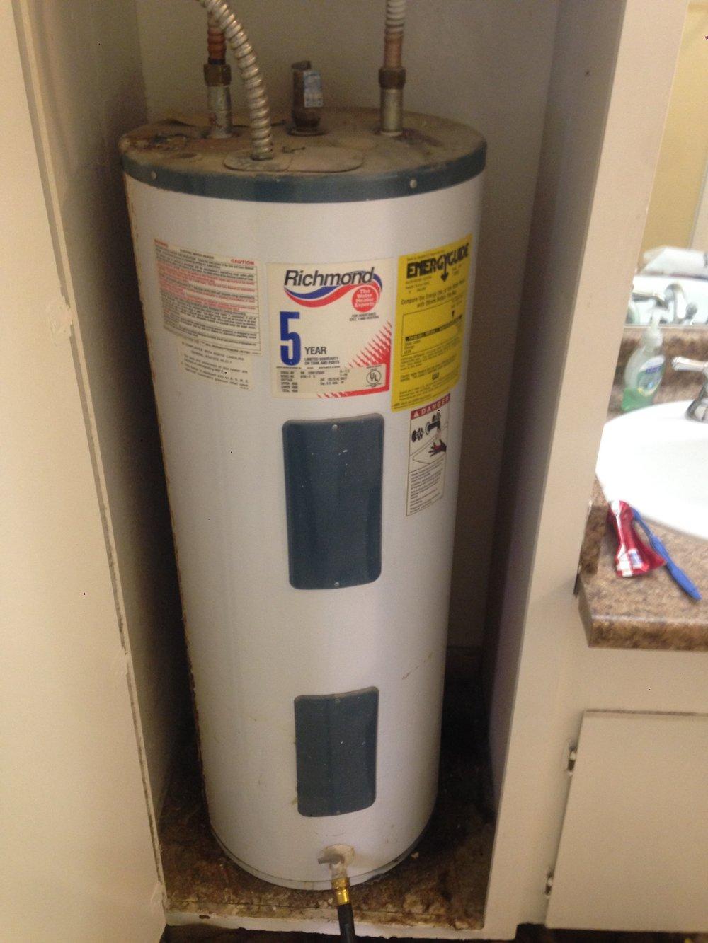 Before - Leaking Water Heater