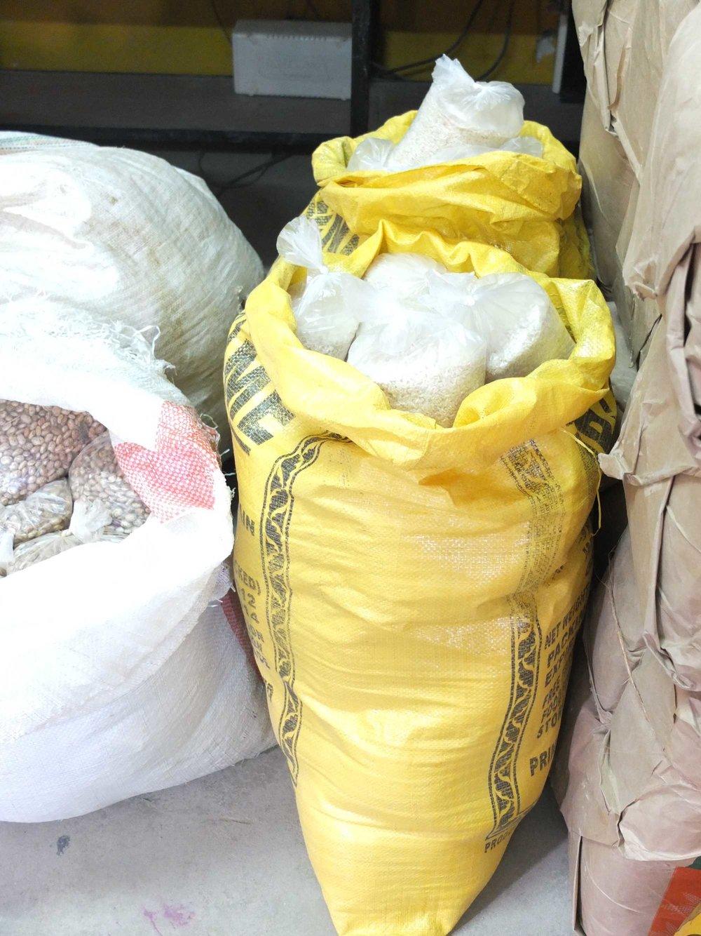 overflowing-bags-of-rice.jpg