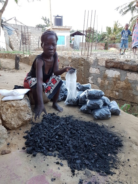 Mama Steven with her new charcoal business