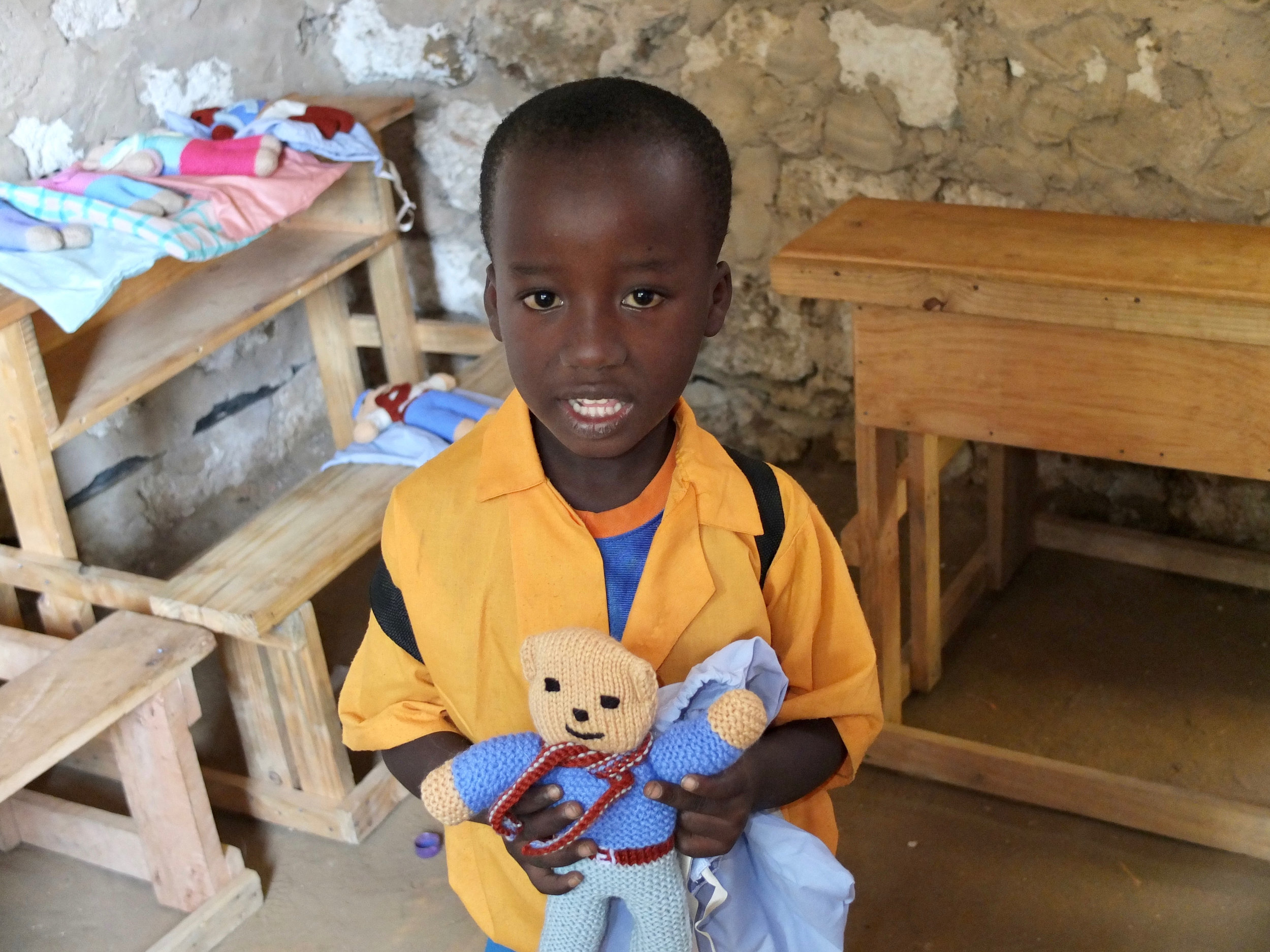 Steven in January 2013 receiving a teddy from Milele, before he was sponsored