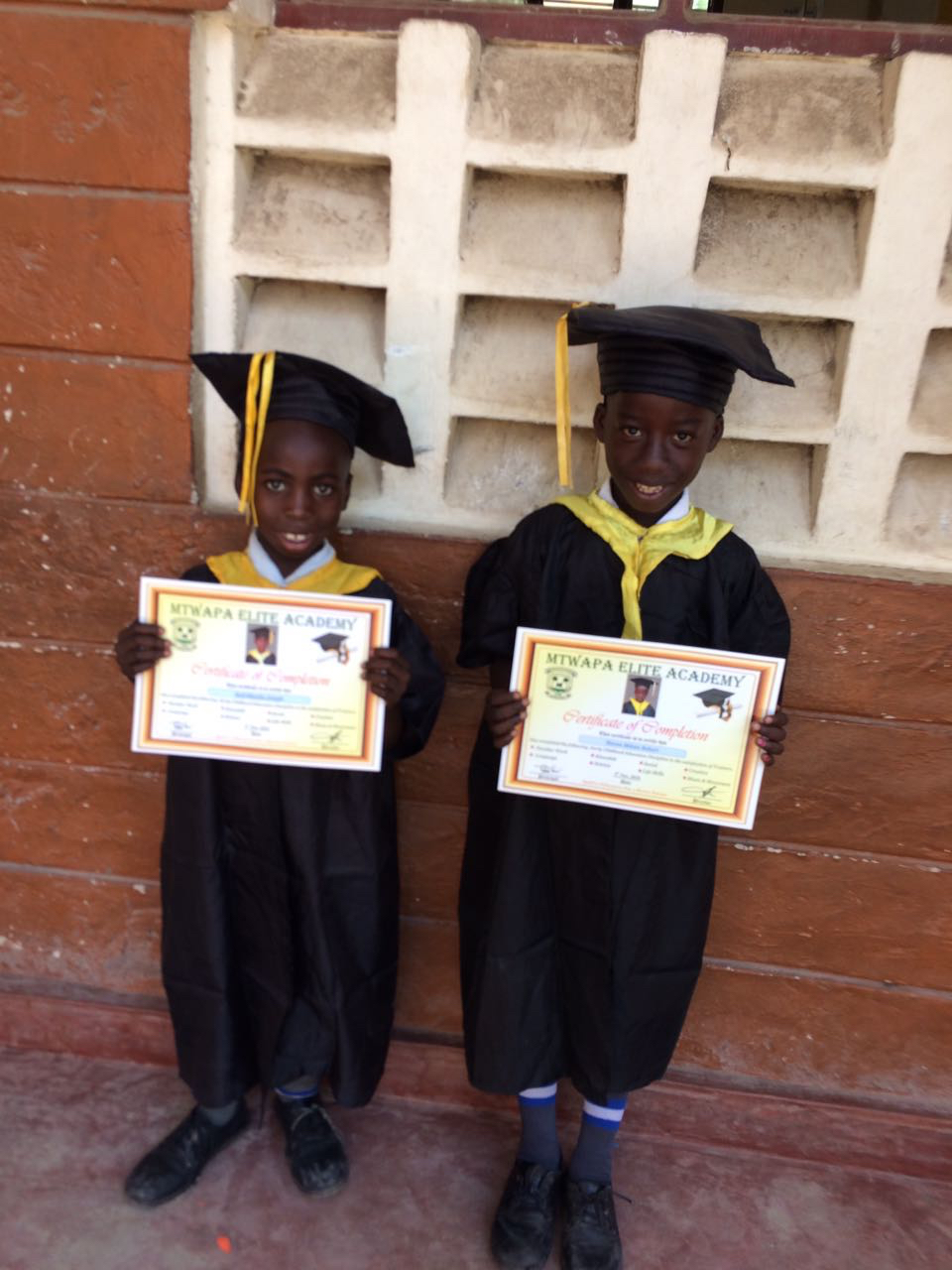 The first Milele children to wear graduation caps - watch out Emmanuel Kai, you're not the only graduate-to-be on the block now!!!