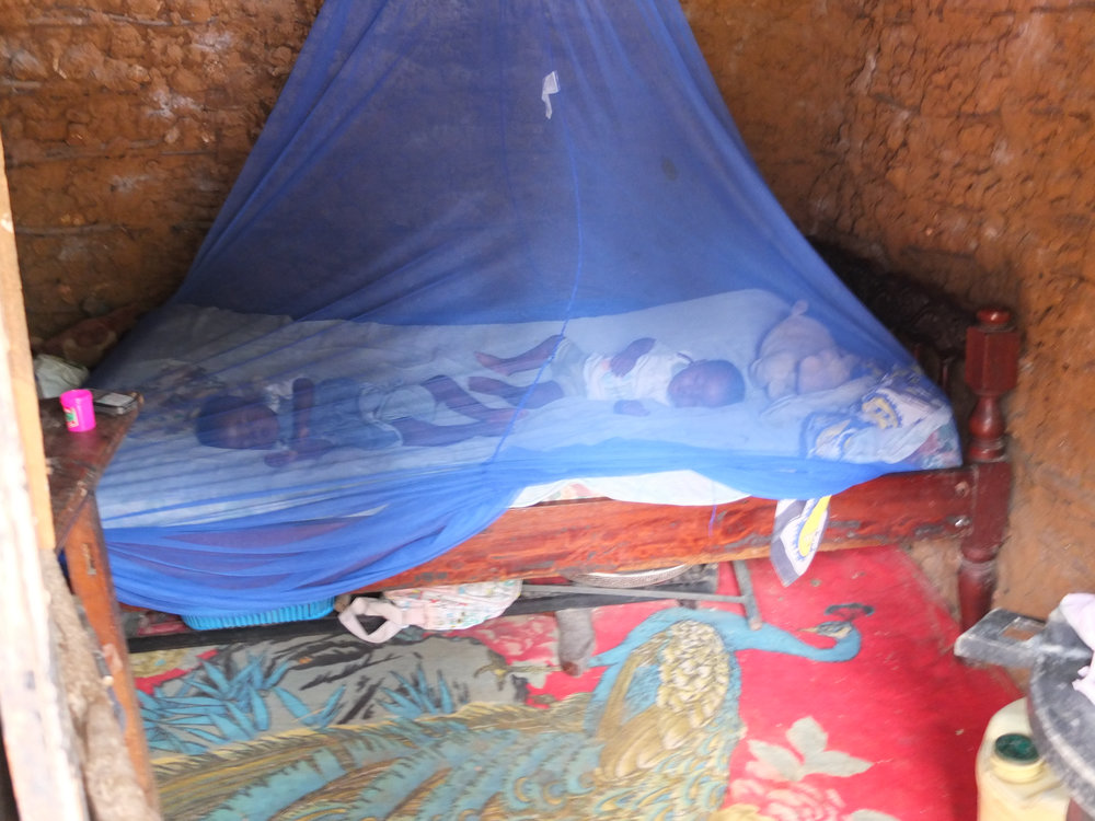 Mosquito Net in use (2013). One mother told her that none of her children had been sick with Malaria that rainy season, thanks to her mosquito net. Donate £7.50 to buy one for another family.