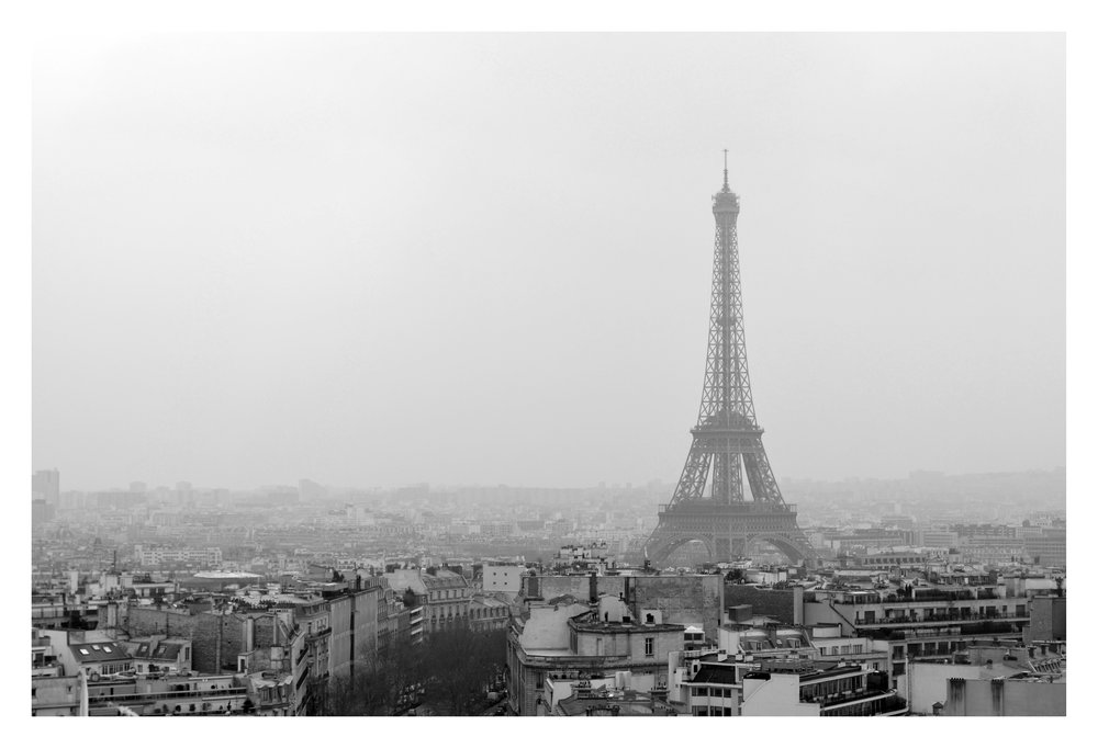 Eiffel Tower - Paris, France as seen from the top of the Arc d'Triumph. It was very rainy, cold, and foggy that day which made for a different view than normally seen of this famous monument.
