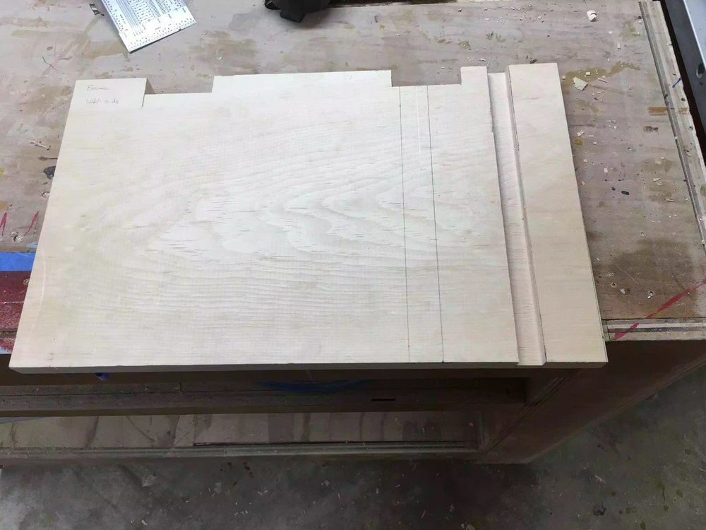 In this picture you can see the base with the notches cut out in the back and the first dado cut into the the right side. (More to come on this part)