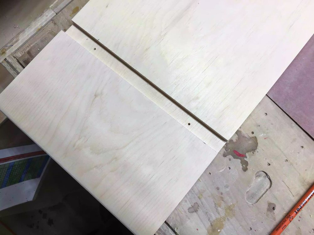 Here is the screw holes positioned, to make sure that countersinked holes were placed in the right position I drilled through holes from the inside of the dado and then flipped the board over and use my countsinking bit.