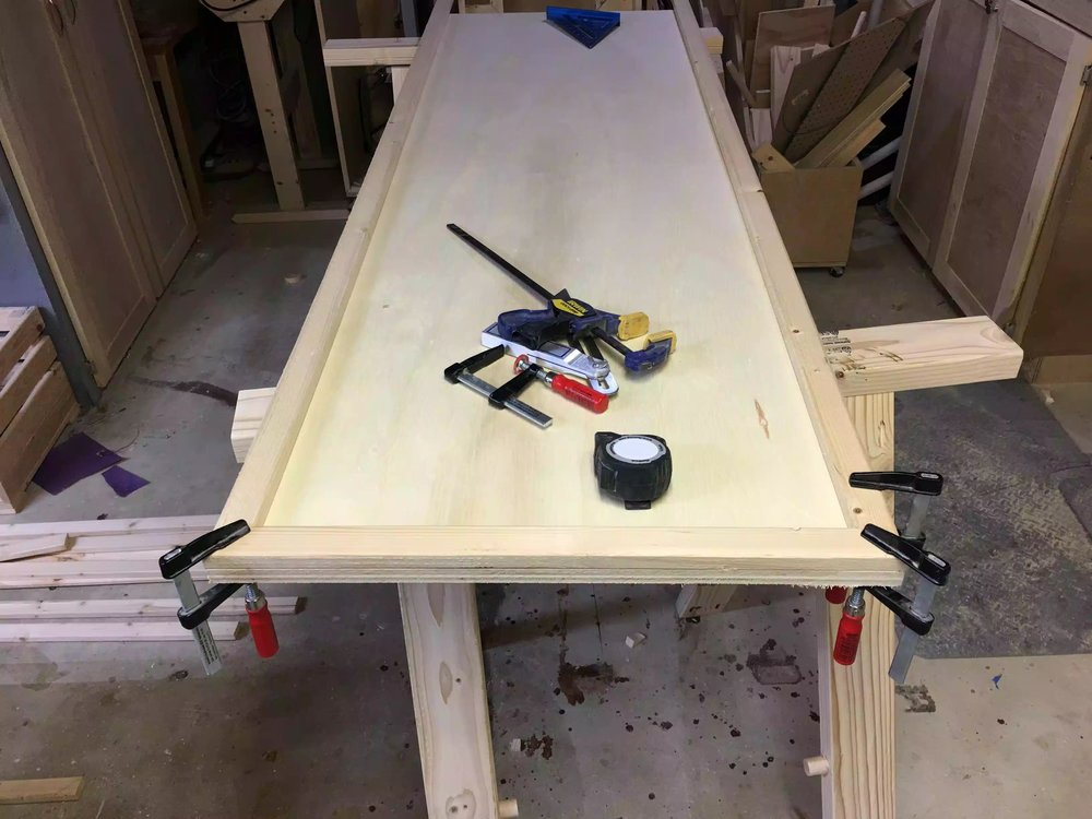 Here I am trying to get correct miter cuts on the corners, I used clamps to secure the corners to make sure they line up when it comes to securing them.