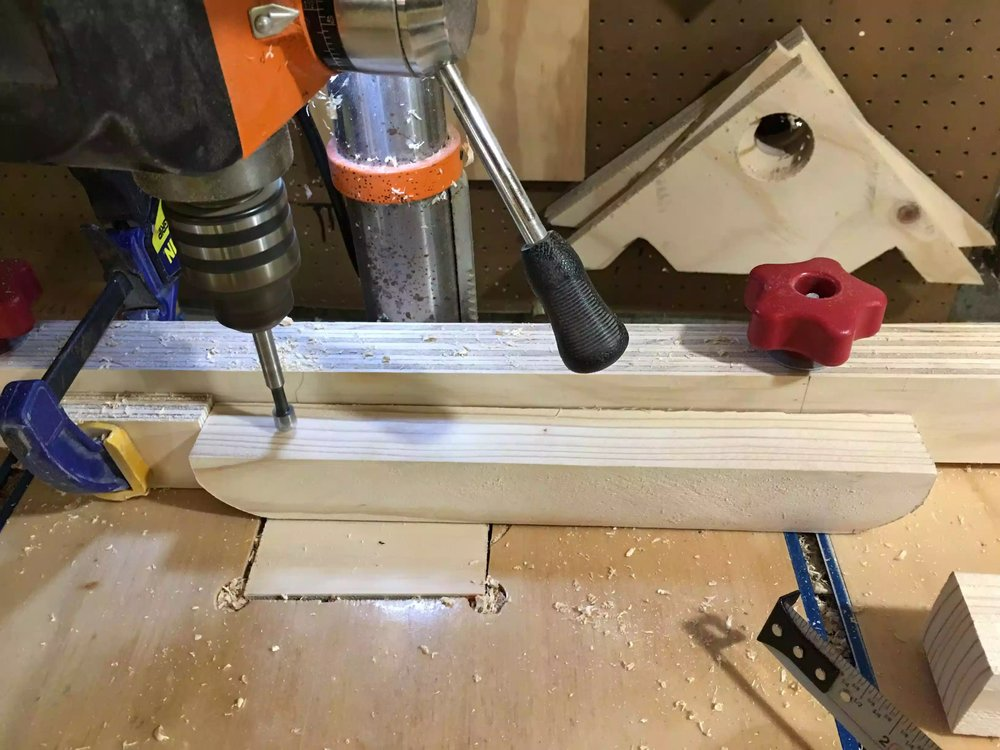 "Here I am making the 3/8"" diameter holes to insert the castor stems for the wheels, I set up a stop block on my drill-press so as that the holes are centered and 1 1/2' from the ends of the foot"