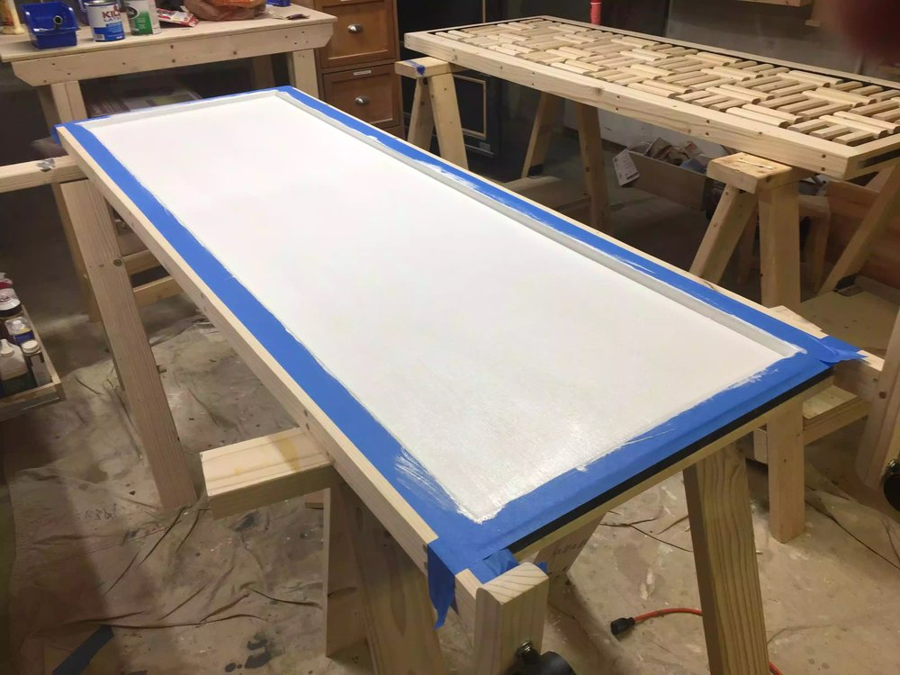 "Here is the panel after the primer has been applied, I used a 6"" roller to apply and the painters tape kept the primer away from legs and face frames of the panel."