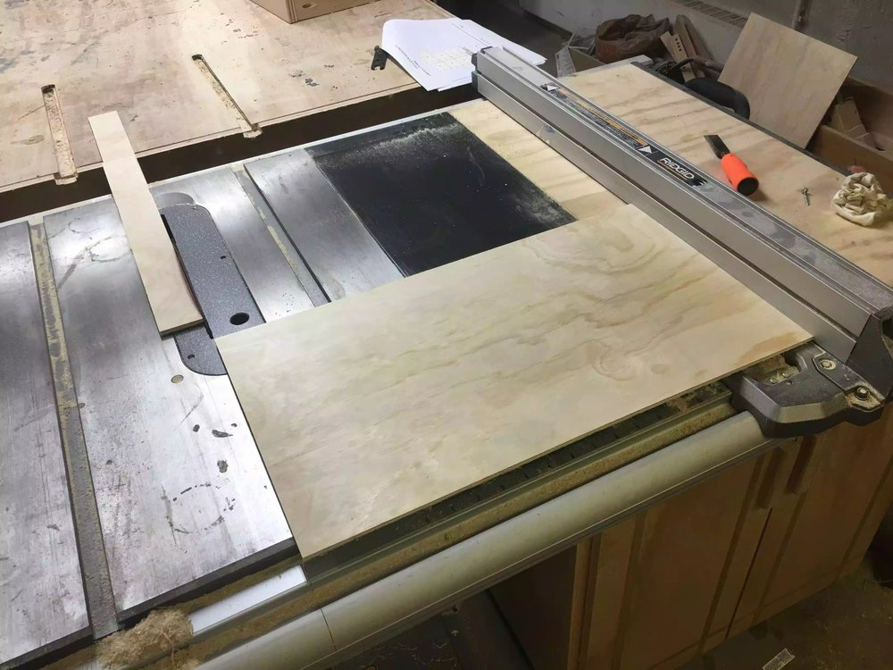 Here is a picture of me cutting the plywood into smaller sections to fit the drawer base.