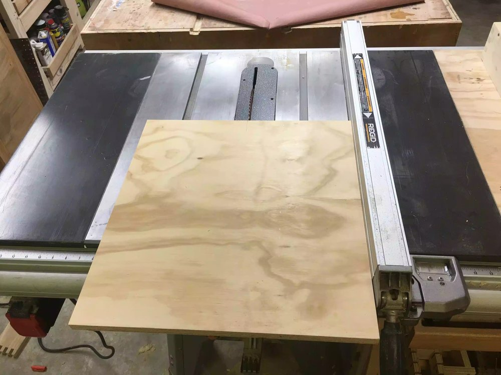"I used this scrap piece of 3/4"" plywood for the base. I am cutting it down to final dimensions here on the table-saw."