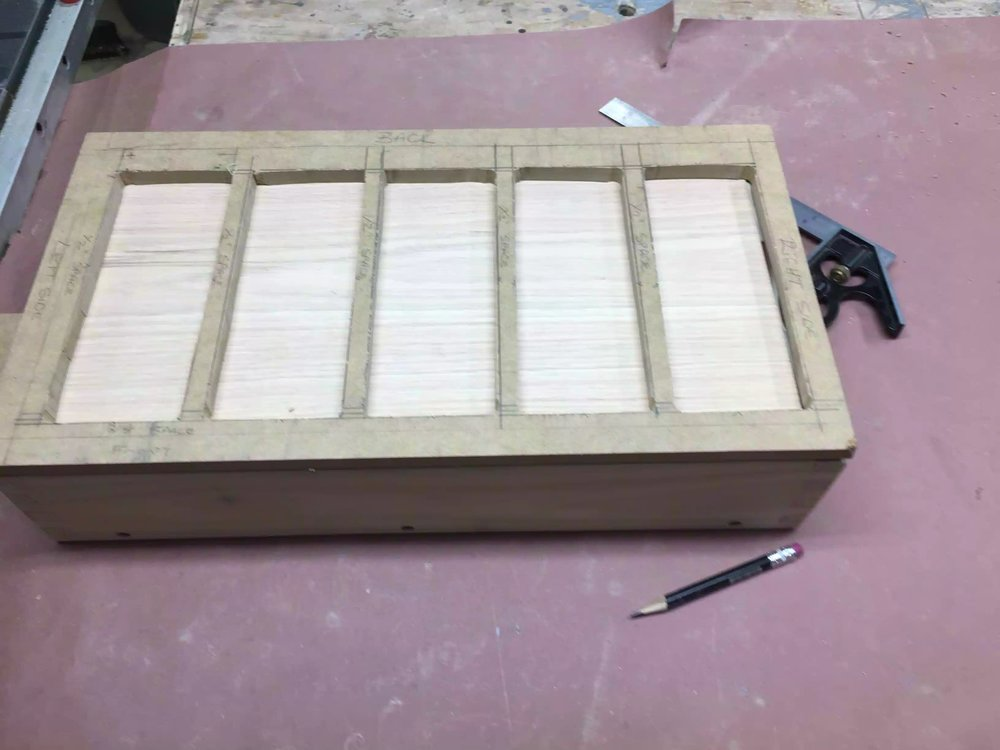 Here is a picture of the template on the oak work-piece, I used double-side tape to secure the template to the oak top.