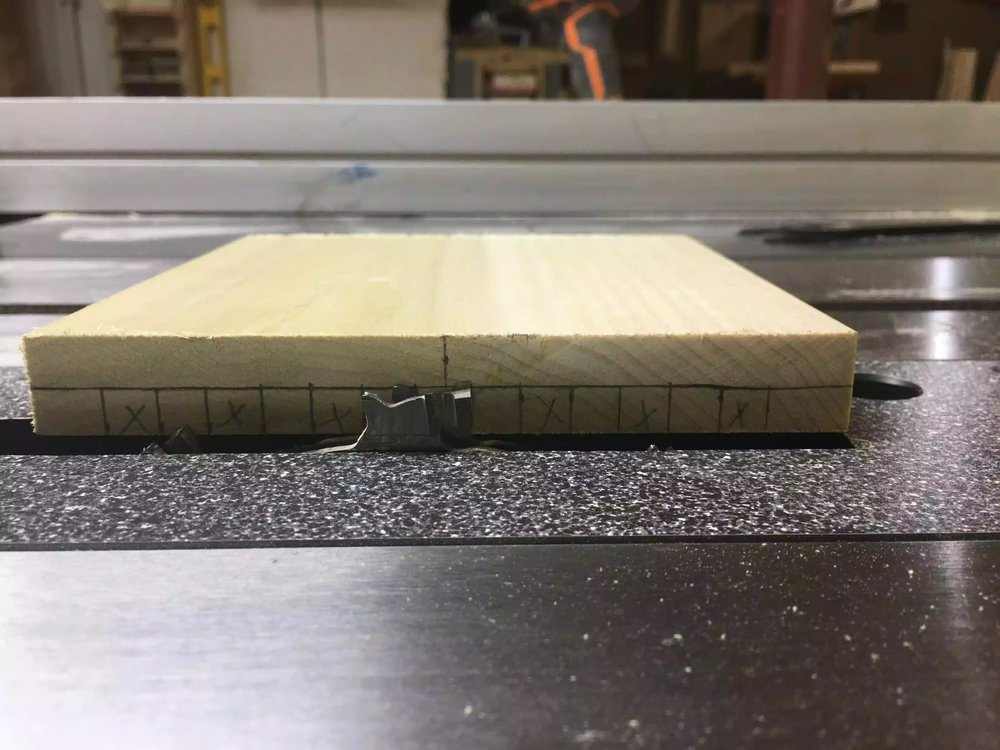 "Here you can see the dado stack measuring up-to the 3/8"" line on the blank edge."