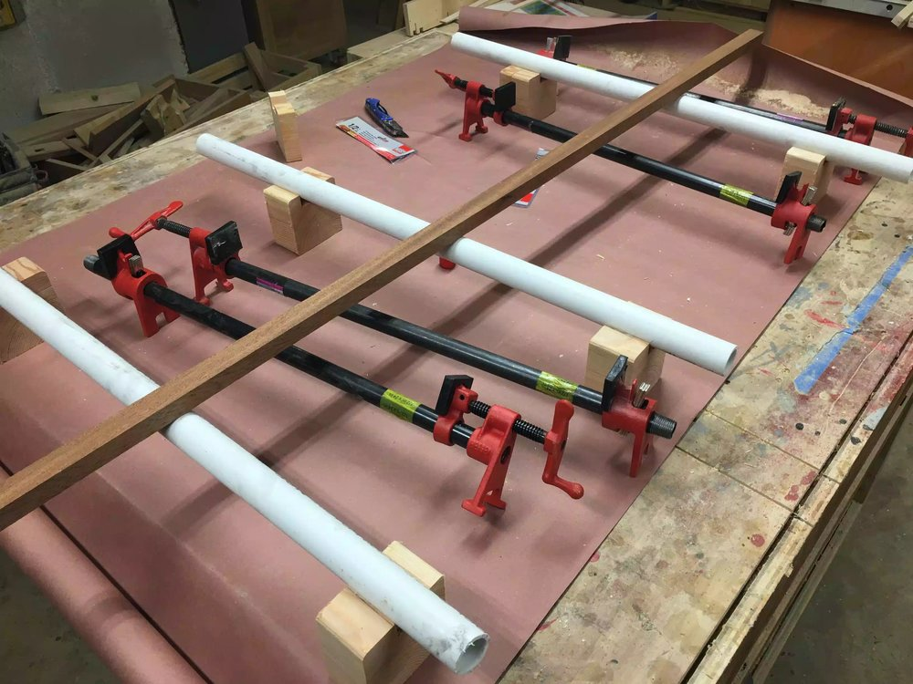 The idea of the white pipe was that it gave the work-piece a flat surface to sit on, and it also afforded me to add height to the glue up so as that I could place clamps on the bottom and top surfaces of the work-piece.