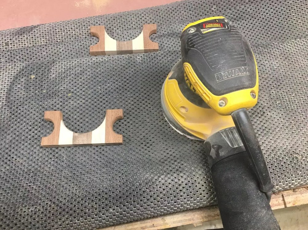 Here is a image of my sander and the non slip router mat but I use almost all the time when I need to sand something that is very small and clamps and vises are not the best options to hold down the work-piece