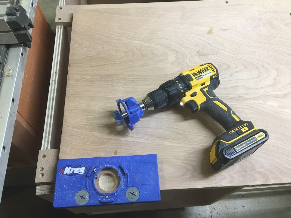 The jig comes with a stop and drill guide to keep the hole straight and plum and the stop prevents you from not going through the door.
