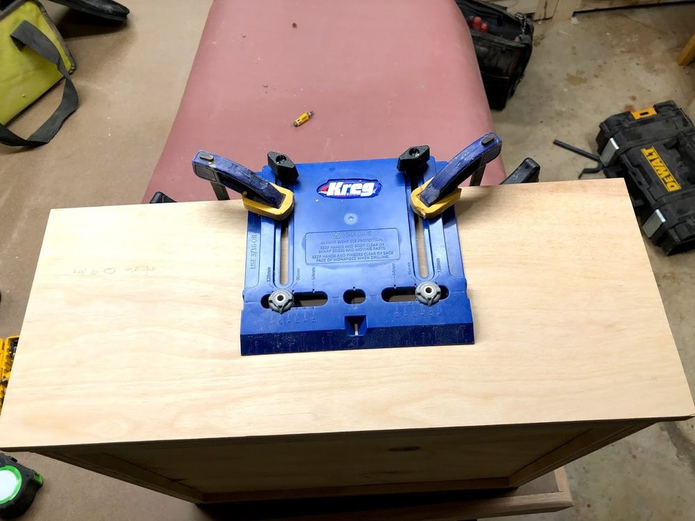 With the center of the drawer marked I lined up my Jig and predrilled the 2 holes required to secure the drawer pulls.