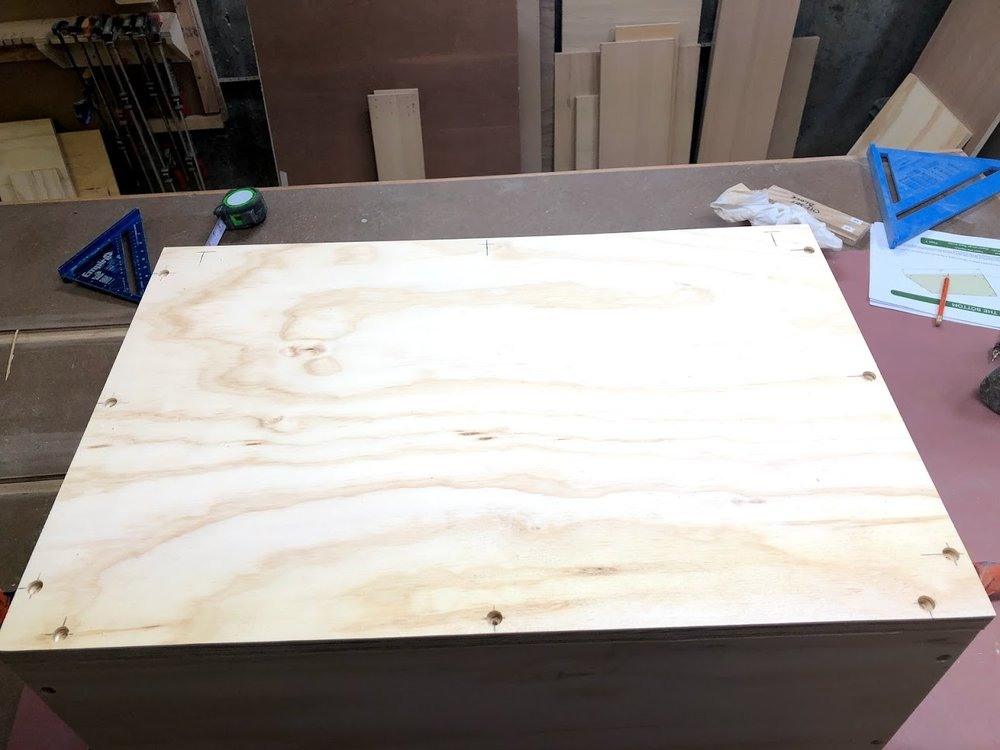 """Using a 3/8"""" space I positioned all the holes s as that the center of the screw would meet the plywood in the center, thus reducing the need for the plywood sides of the box to split."""