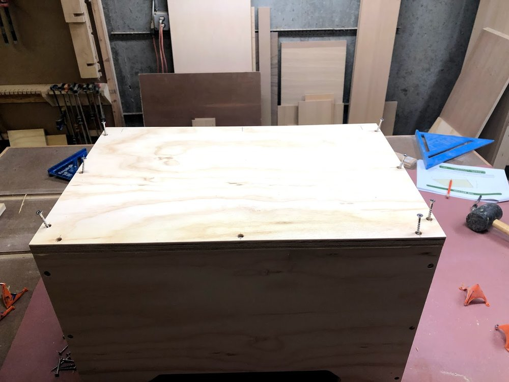 With glue applied to the bottom of the case sides I positioned the base in place and secured it with stainless steel counter sunk screws.