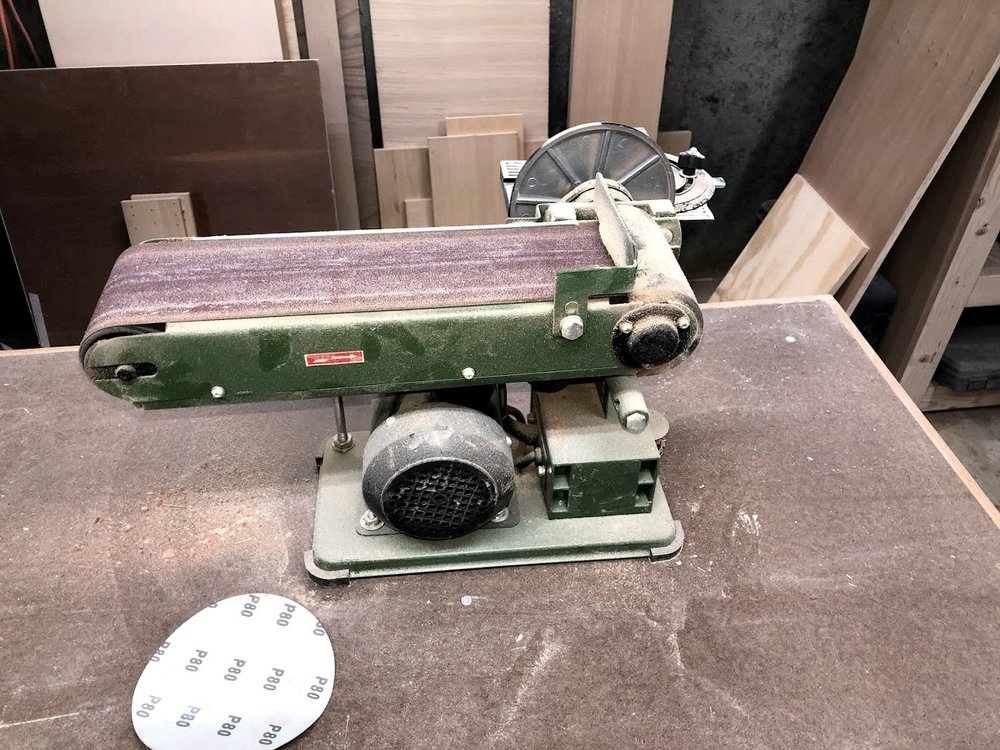Belt sander installed with 100 grit belt sanding paper.