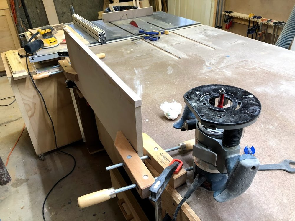 Getting ready to flush trim the side panels, here you can see my router with the flush trim router bit installed.