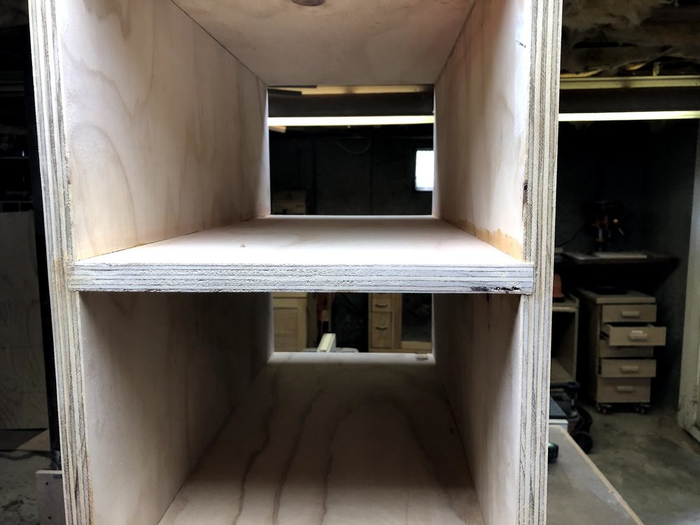 Here you can see the shelves sitting in the dado grooves, these shelves are not going anywhere. I will need to sand the unit down but its made.
