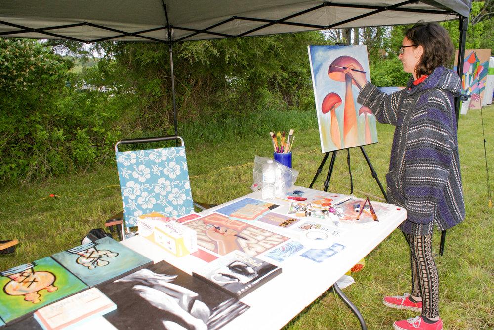 Artists live painting at TCC Fest