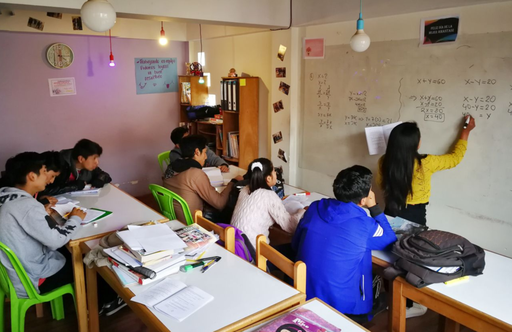 The young people take part in maths class in preparation for their further education entrance exams.