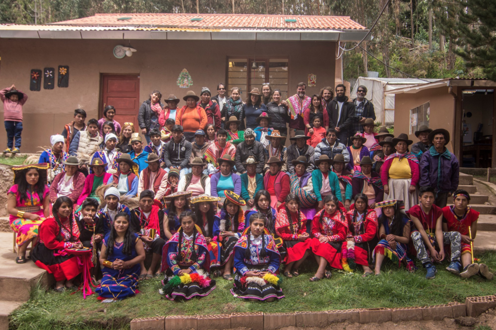 The young people and their parents group for a photo to remember the special day.