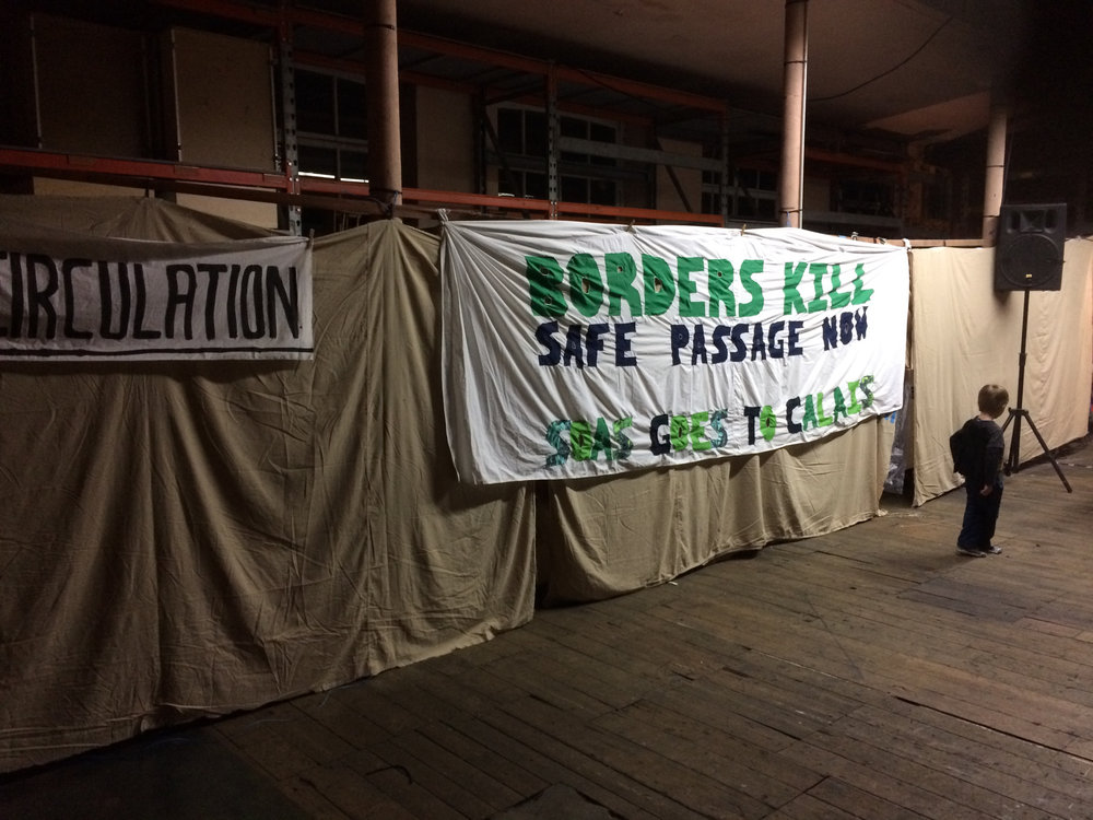 A banner brought to Calais by London University SOAS student volunteers