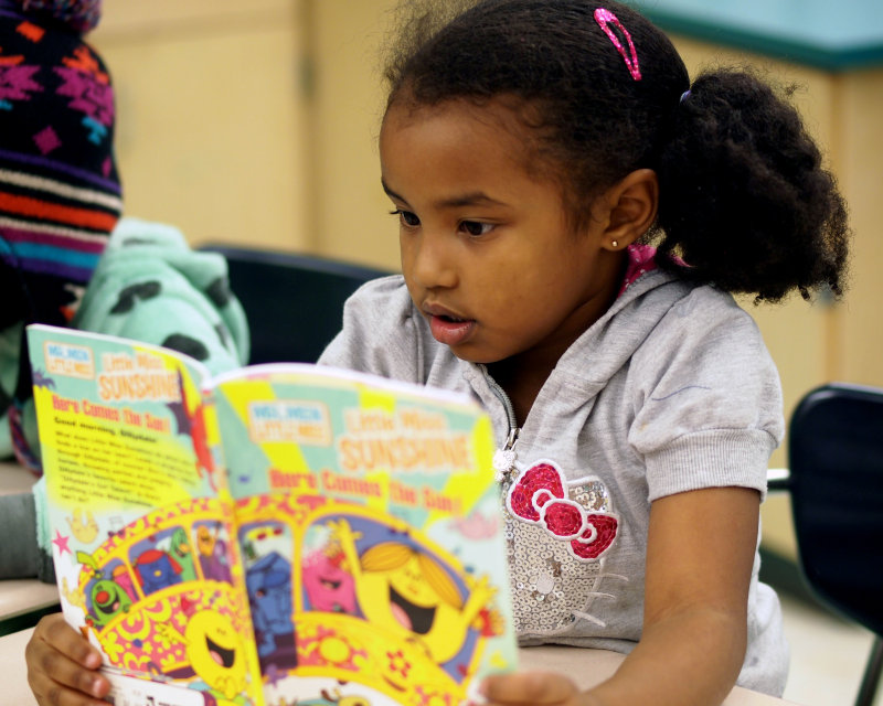 Girl w book sat bridges.jpg