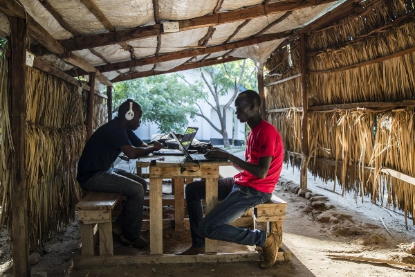 Students Jimmy Onono (left) and Ajak Mayen went over course work on laptops at the facility where Southern New Hampshire University has a degree program in the UNHCR refugee camp. Photo Credit:  Keith Bedford/Globe Staff