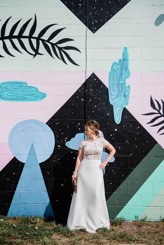 Bride in front of street art in Boulder, Colorado