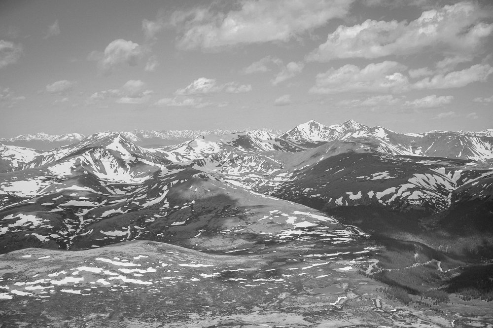 Adventure photography session hiking a 14er with views for miles