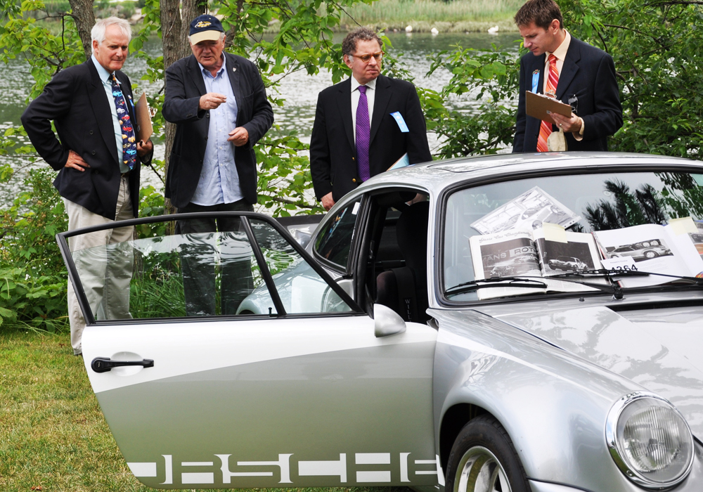 Murray Smith chats up the judges. Lots to tell about this very special Porsche which won Best German Sports, 1946-75