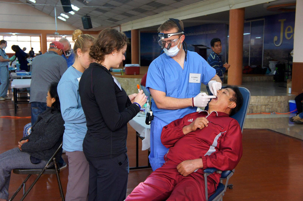 Ambassador Service Group Interpreters working with Doctor in Ecuador to triage patients.