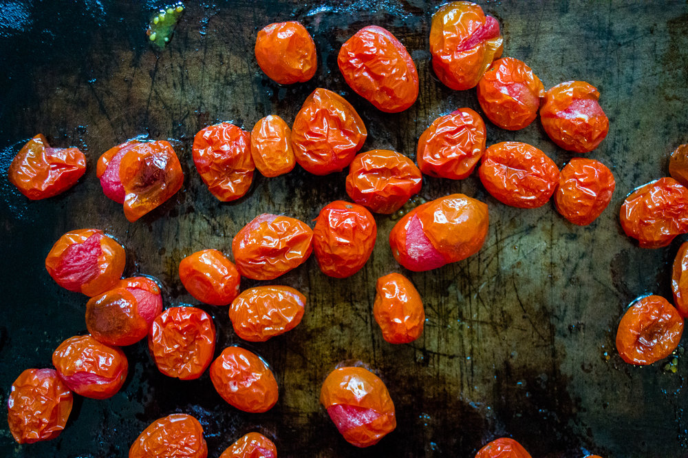Wrinkly raw tomatoes turned into delicious jammy roasted tomatoes