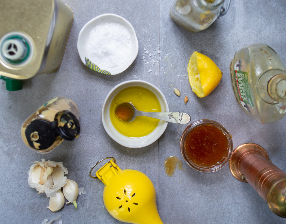 lemons, honey, mustard, garlic, olive oil, and other items to make vinaigrettes