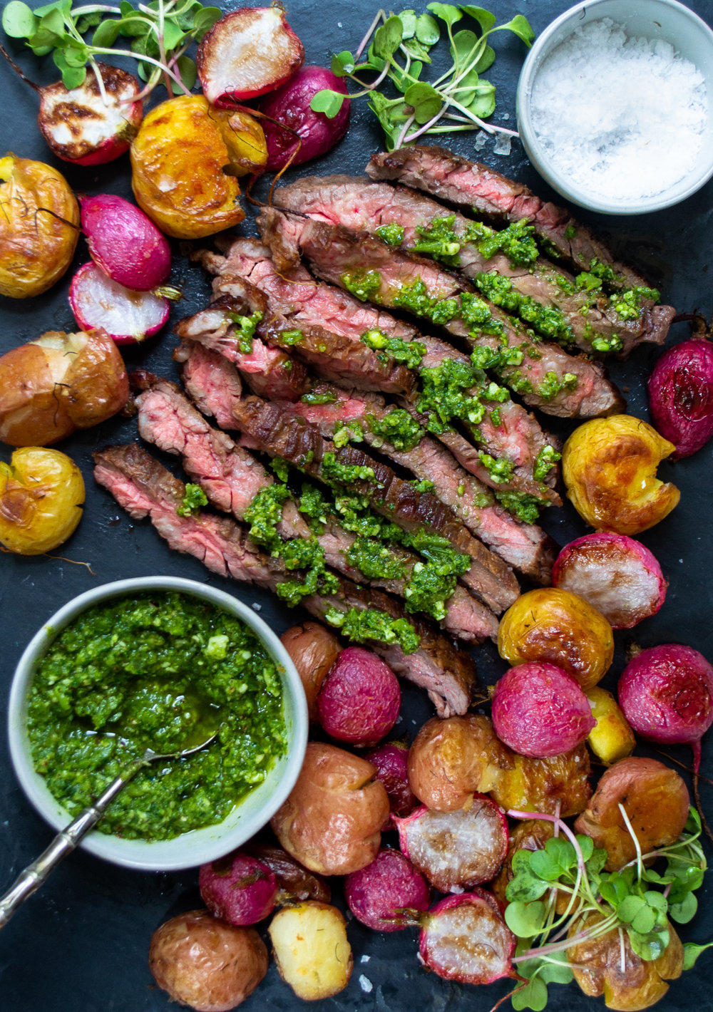 skirt steak with crispy smashed potatoes, roasted radishes and radish greens salsa verde