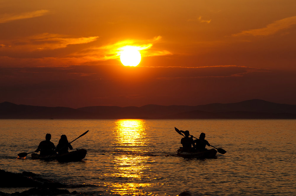 Kayak-the-sunset-yoga-travel-retreat