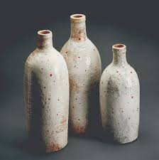 Stoneware bottles with red underglaze