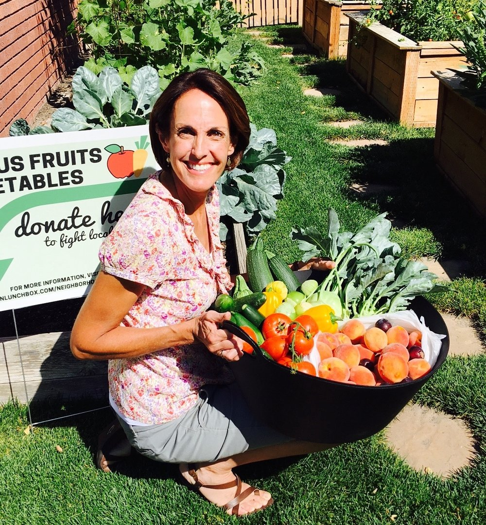 Backyard GardenShare founder, Pat Thomas, collecting fresh produce from her garden.