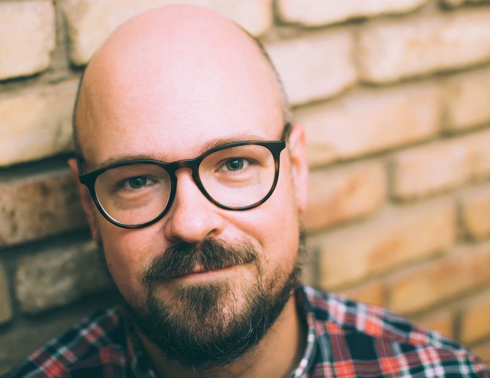 Ralphie Hardesty - Ralphie Hardesty is a standup comedian and current host of GFQM - Austin, and he co-founded Queer Mountain with Micheal Foulk. As a comedian, Ralphie performs regularly with Master Pancake Theater and at comedy clubs in Austin. Hardesty is a veteran of many festivals around the country, and you probably missed his TV appearances unless you watch a lot of PBS or the Ovation Network, which is a real thing. However, Ralphie is most proud of the successes around Greetings From Queer Mountain and the communities and people who lend their talents to the show.