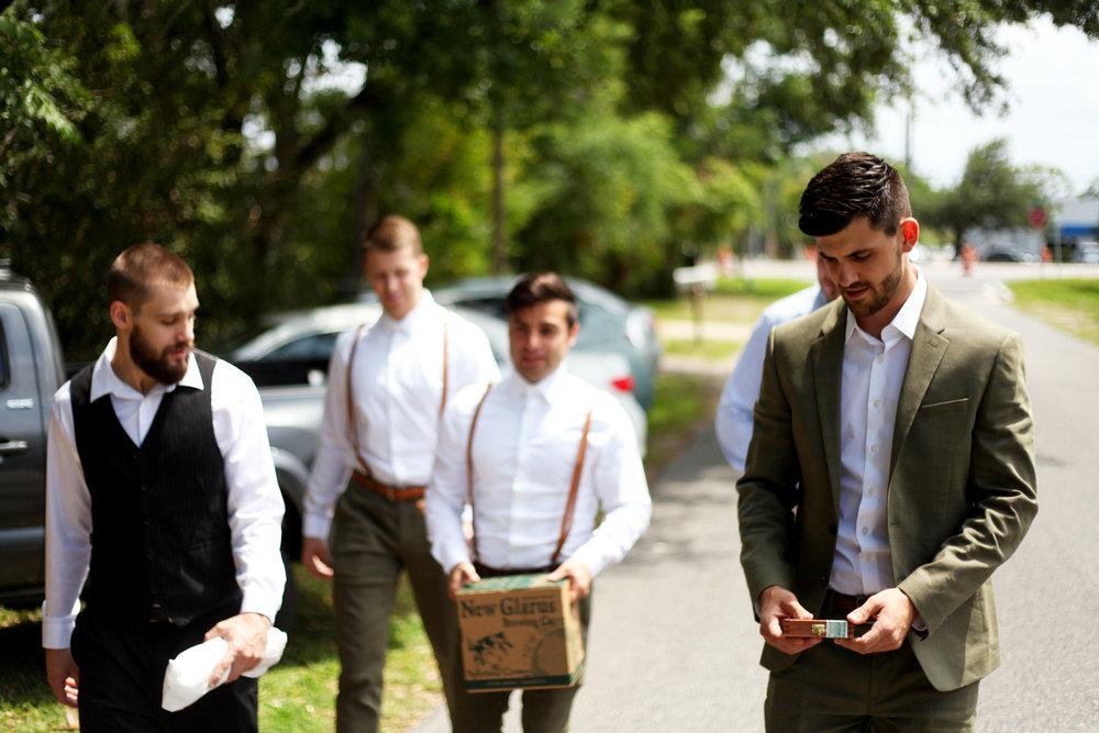 Josh and the groomsmen walking to the wedding