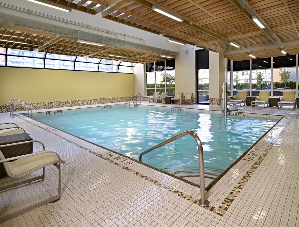Residence Inn Downtown Vancouver - Centrally located downtown, the Residence Inn features a shallow pool and natural light ideal for kids and beginner adult lessons. Enjoy lounge seating in a comfortable environment with an outdoor view, complimentary towel-service, on-deck showers, and a hot tub for swimmers to warm up in.