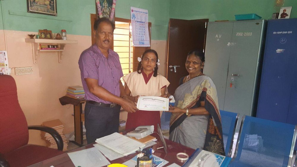 Culvee Scholar receiving Certificate from Culvee Team & Principal