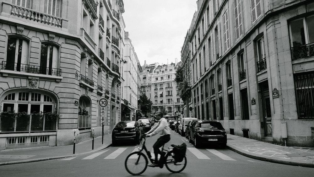A man rides his bike in Paris