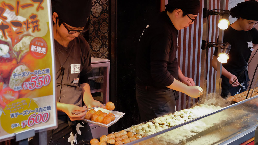 Takoyaki being made in Dōtonbori, Osaka