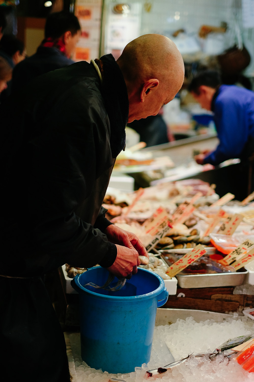 Fish seller at Nishiki Market in Kyoto