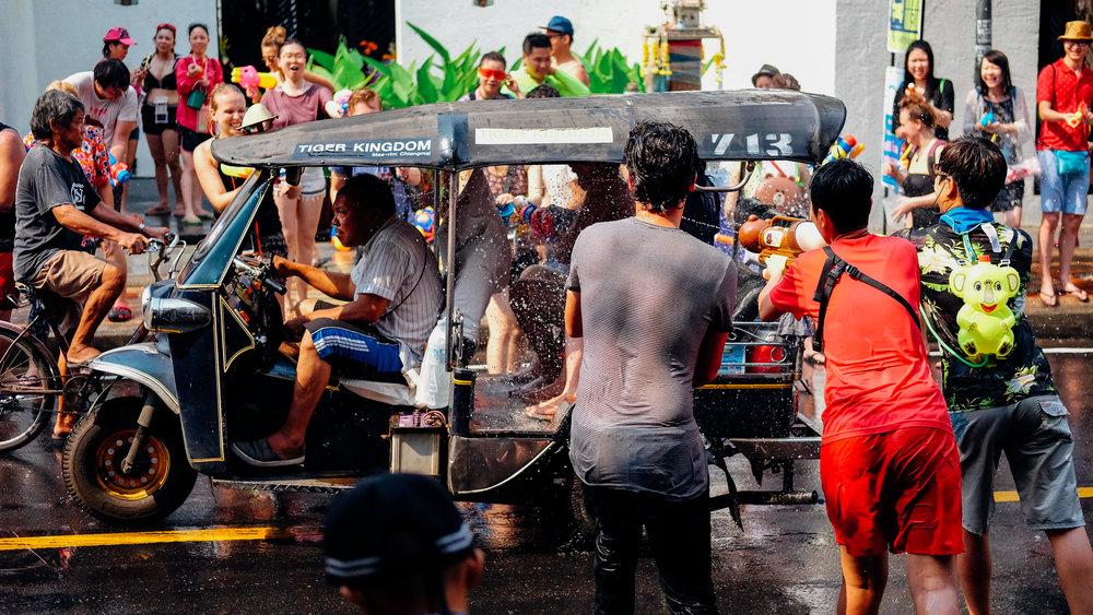 Soaking the tuk tuk driver during Songkran