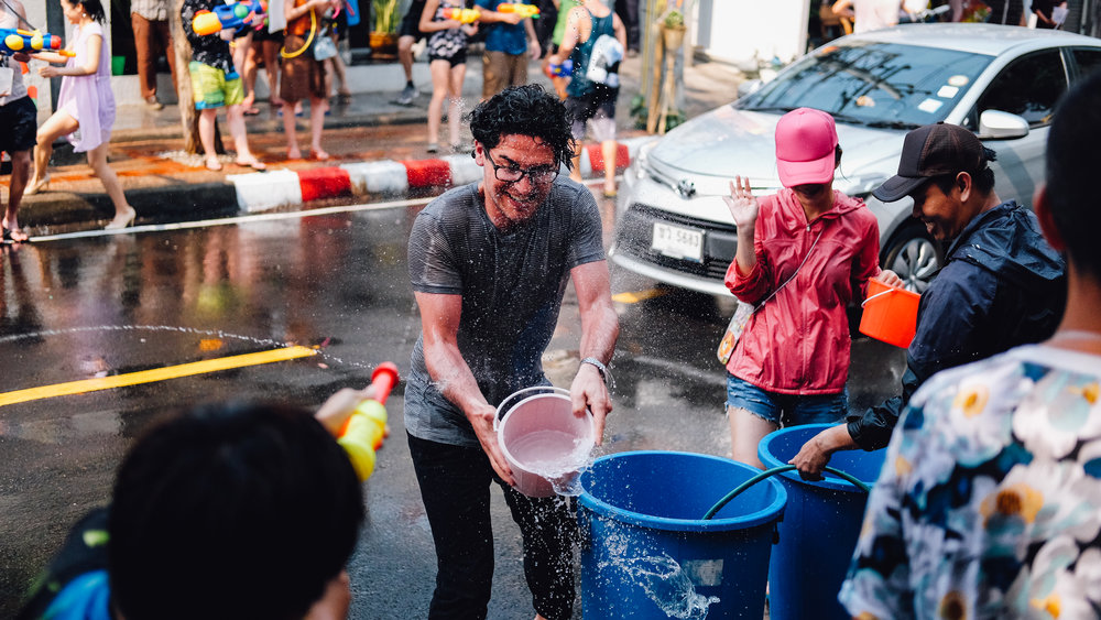 Throwing buckets of ice cold water during Songkran